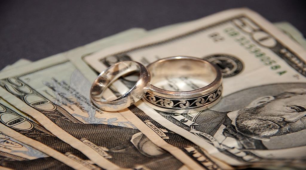 Wedding rings on top of money