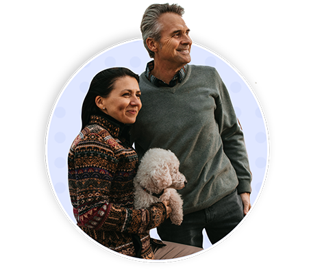 Couple holding their pet dog